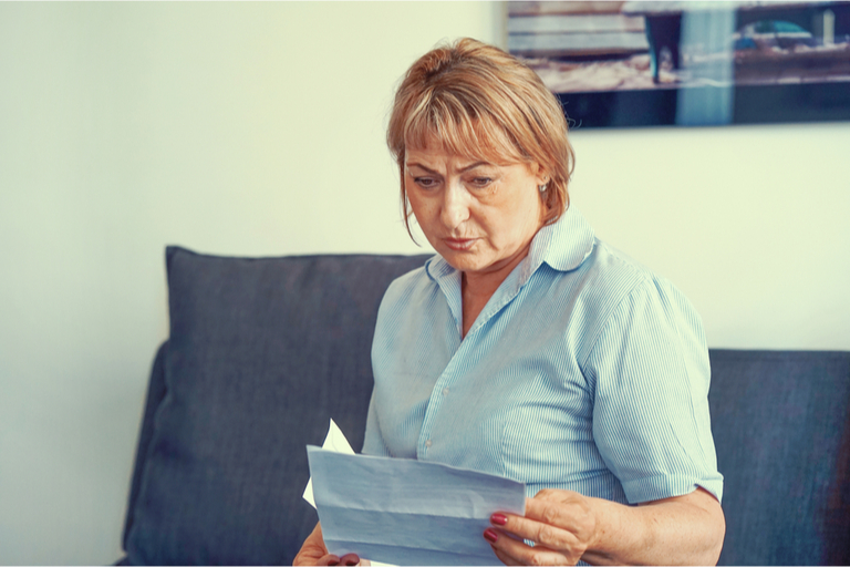 upset lady reading a letter